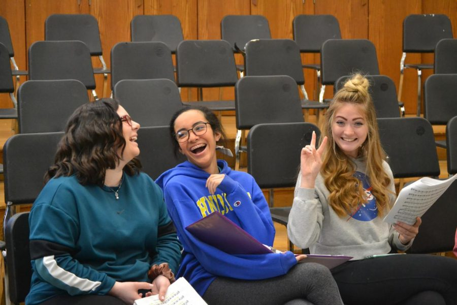 Chorus members rehearse songs for Beauty and the Beast.