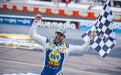 Avondale, Arizona, USA; NASCAR driver Chase Elliott celebrates with the checkered flag after winning the NASCAR Cup Series Championship at Phoenix Raceway.